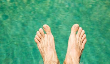 feet hovering over water