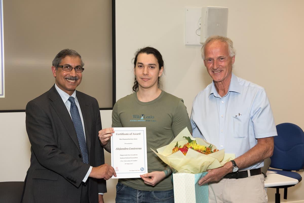Dr Babulal Sethia & Dr Paul McMaster awarding winner Alejandro Contreras