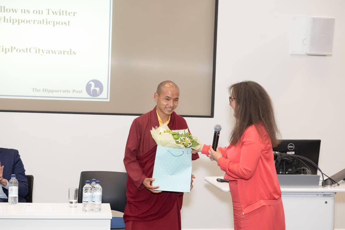 Wangchuk Rapten being presented flowers by Thea Jourdan